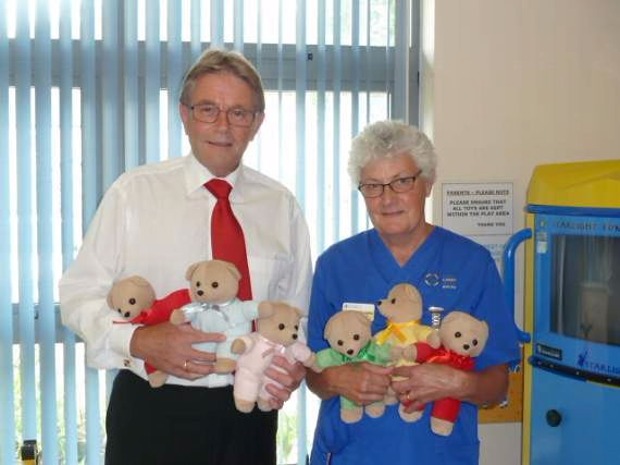 Photo of Steve Thurgood is pictured at the new Walk-In Centre with nurse Heather Willoughby and a few of the cuddly bears.